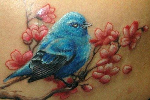 Птица на вишневой ветке